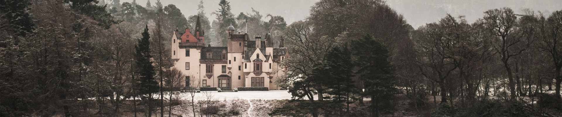 Photo of Aldourie Castle in the snow