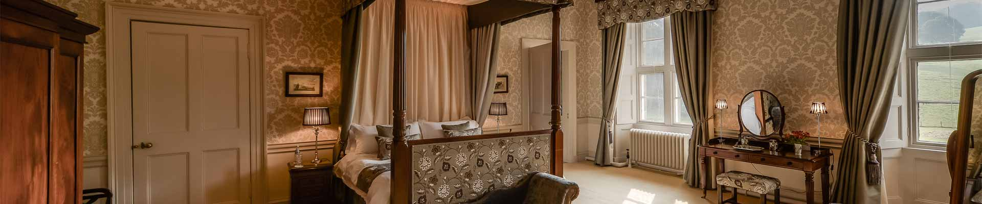 Photo of one of the bedroom suites at Lachlan Castle