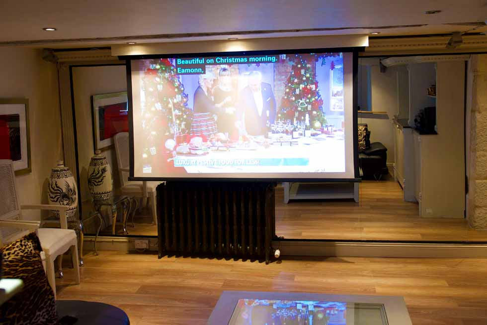 Large cinema screen at Court House Manor