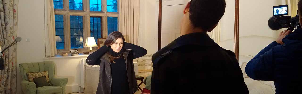 Susan Li from CNBC being filmed in one of North Cadbury Courts bedrooms