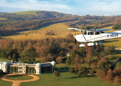 Photo of a plane flying over Goodwood House