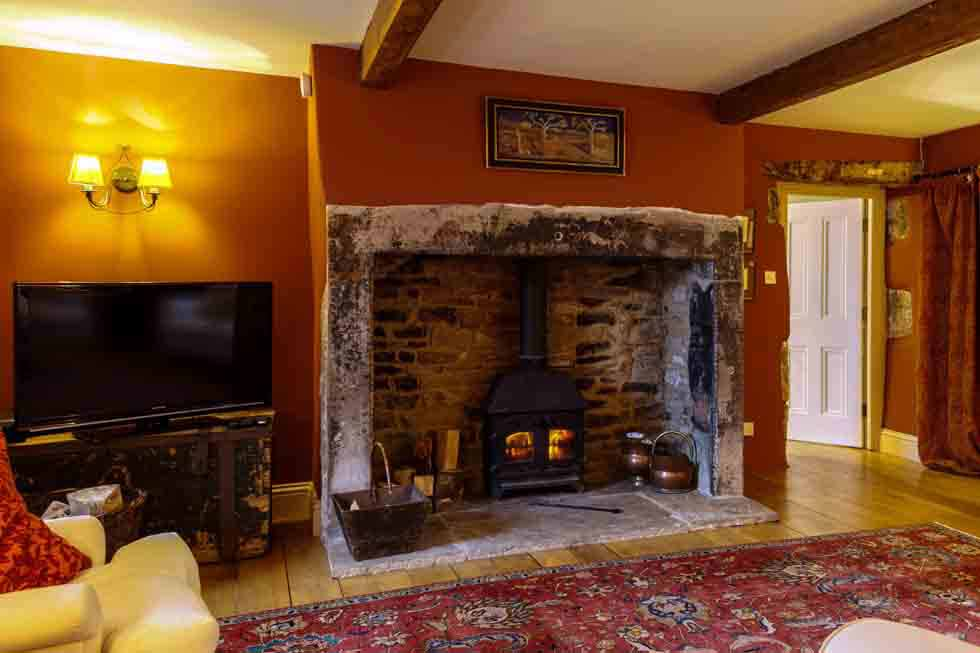 The beautiful lounge fireplace at Maylie Cottage