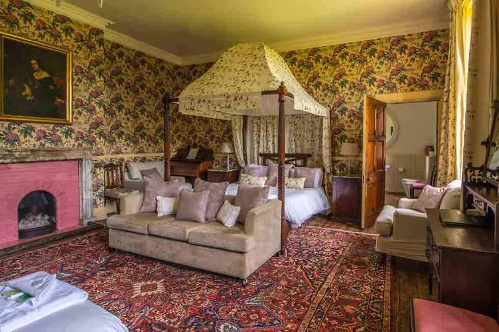 One of the stunning bedroom suites at Huntsham Court
