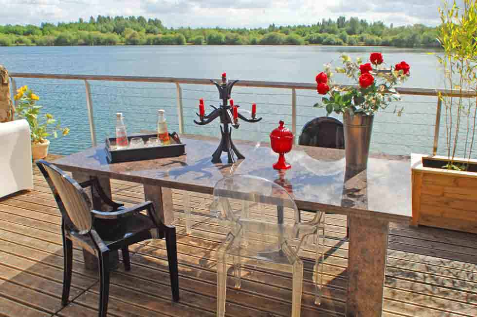 Enjoy a drink on the lake at Larchwood Lodge