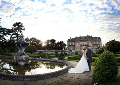 Photo of a wedding by the Luton Hoo pond