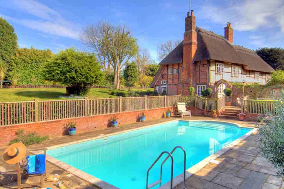 Enjoy swimming in Manor Farmhouse's outdoor swimming pool