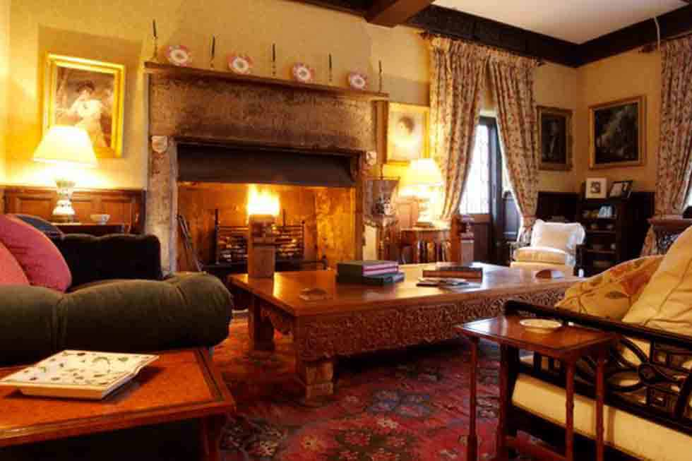 Enjoy a large fire at Pentrehobyn Hall