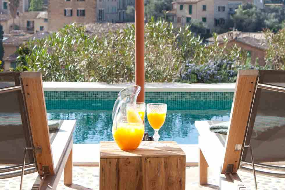 Enjoy a drink by the swimming pool of Sa Llupia
