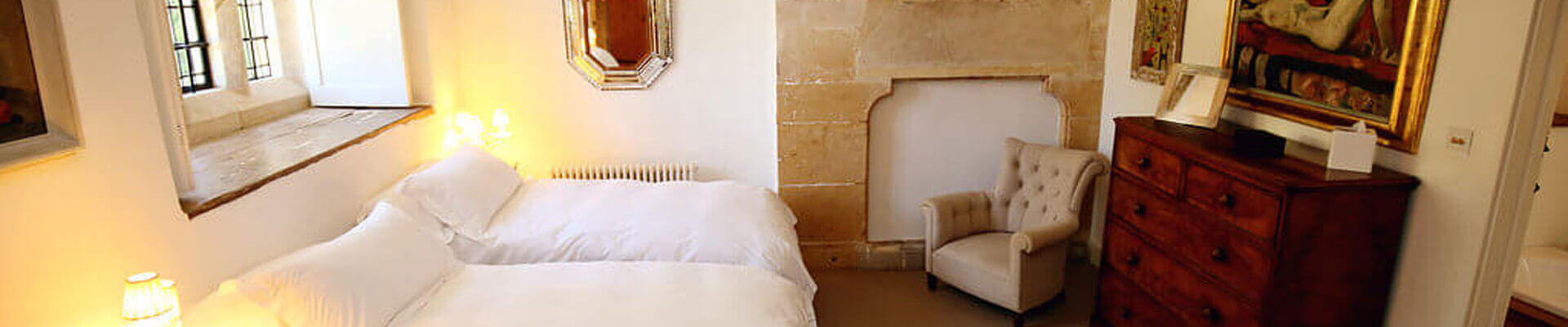 Photo of one of the bedrooms at Temple Guiting Manor