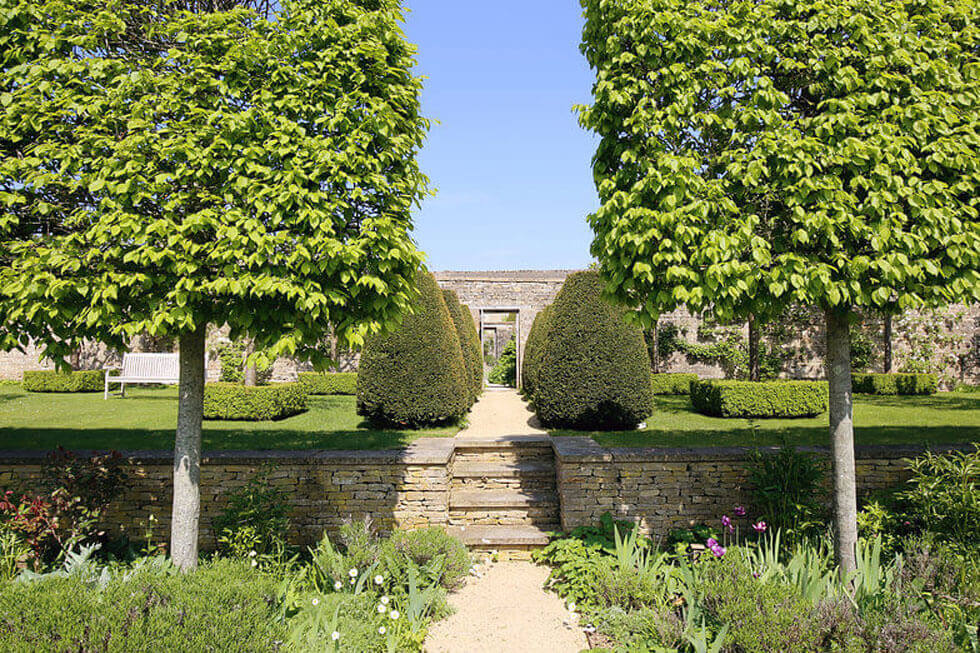 Photo of some of the stunning gardens at Temple Guiting Manor
