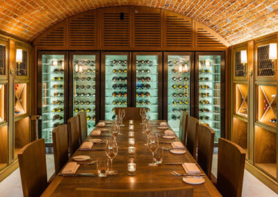 Photo of a dinner in the wine cellar at The Langley