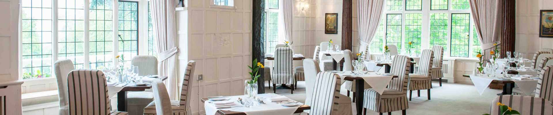 Photo of one of the dining rooms at The Manor Elstree
