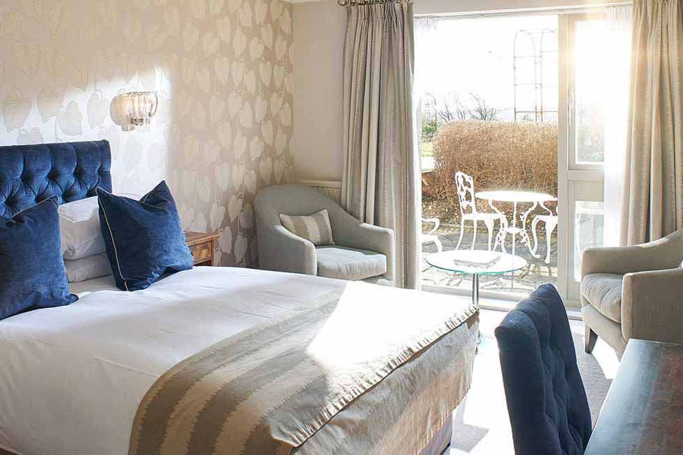 Photo of one of the superior bedrooms at The Manor Elstree