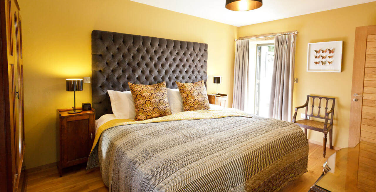 Photo of one of the beautiful ensuite bedrooms at Tregulland Barn