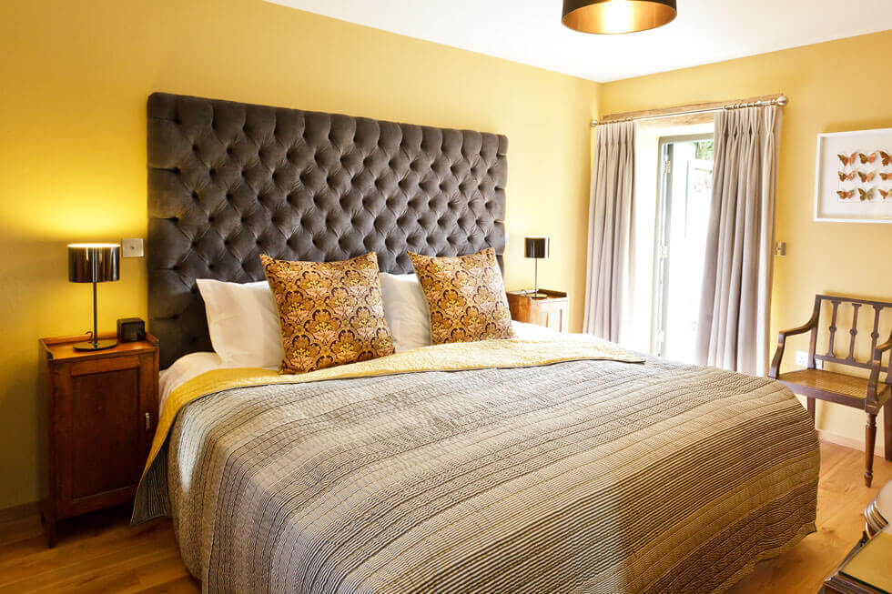 Photo of one of Tregulland Barns' bedrooms