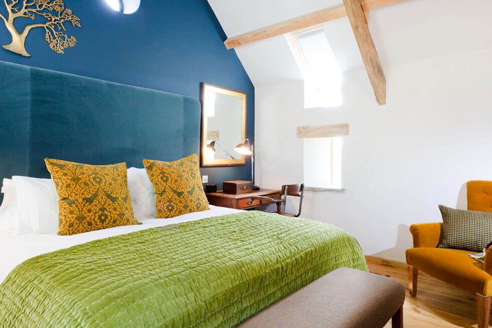 Photo of one of the luxury bedrooms at Tregulland Barn